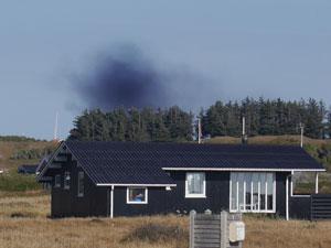Rauch über einem Ferienhaus